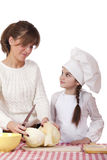 Cooking and people concept. Little girl in cook hat and mother, isolated on white background stock photography