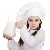Cooking and people concept - Little girl in a white apron holdin Stock Photography