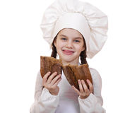Cooking and people concept - smiling little girl in cook hat Stock Photos