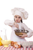 Cooking and people concept - smiling little girl in cook hat. Isolated on white background Stock Images