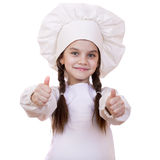 Cooking and people concept - smiling little girl in cook hat Royalty Free Stock Photography