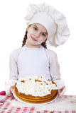 Cooking and people concept - smiling little girl in cook hat Royalty Free Stock Photos