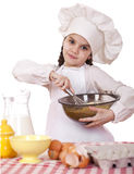 Cooking and people concept - smiling little girl in cook hat. Isolated on white background Stock Image