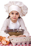 Cooking and people concept - smiling little girl in cook hat Royalty Free Stock Image