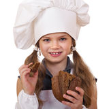 Cooking and people concept - smiling little girl in cook hat Stock Photo