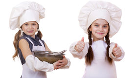 Cooking and people concept - Two Little girls in a white apron Royalty Free Stock Images