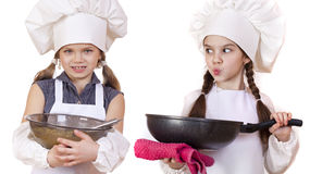 Cooking and people concept - Two Little girls in a white apron Stock Photo