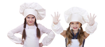 Cooking and people concept - Two Little girls in a white apron Royalty Free Stock Image