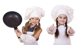 Cooking and people concept - Two Little girls in a white apron Royalty Free Stock Photography