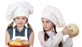 Cooking and people concept - Two Little girls in a white apron Stock Photography