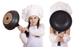 Cooking and people concept - Two Little girls in a white apron Stock Images