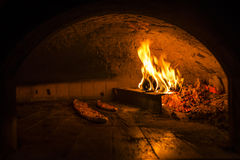 Cooking pide in a stone oven Stock Image