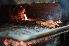 Cooking pieces of raw meat in a brazier on an open fire Royalty Free Stock Photos