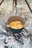 Cooking pilaf on campfire Royalty Free Stock Photos