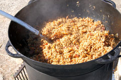 Cooking pilaf dish in outdoor. Royalty Free Stock Photo