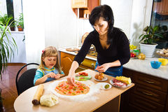 Cooking pizza Stock Photos