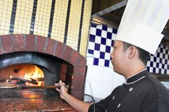 Cooking pizza royalty free stock photography