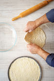 Cooking pizza dough on the kitchen Royalty Free Stock Photography