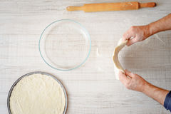 Cooking pizza dough on the table Stock Photography