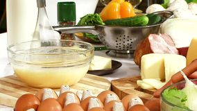 Cooking pizza. The eggs with the milk whisk electric mixer stock video