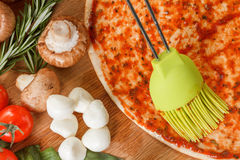 Cooking pizza with fresh vegetables. Food ingredients close up Royalty Free Stock Images