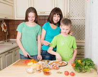 Cooking pizza at home. Filling homemade pizza with ingredients. stock photography