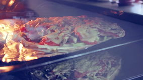 Cooking pizza stock video footage
