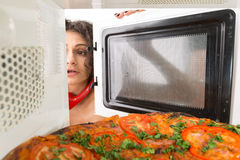 Cooking pizza in the microwave Stock Photo