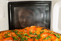 Cooking pizza in the microwave Stock Photos