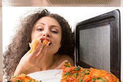 Cooking pizza in the microwave Stock Images