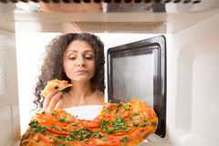 Cooking pizza in the microwave Stock Photography