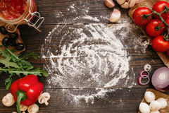 Cooking Pizza. Pizza ingerdients on the wooden table with copy space, top view Royalty Free Stock Images