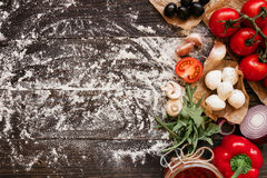 Cooking Pizza. Pizza ingerdients on the wooden table with copy space, top view Stock Images