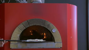 Cooking pizza in stove stock video footage