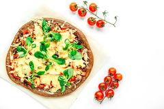 Cooking pizza with vegetables and cheese on white desk background top view Stock Images