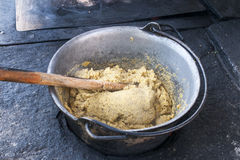 Cooking polenta on wood stove Royalty Free Stock Photos