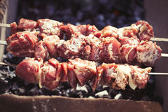 Cooking pork kebab on grill Stock Photography