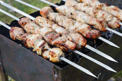 Cooking pork shashlik  on skewer Royalty Free Stock Photography