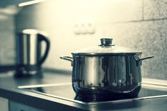 Cooking pot. A cooking pot with glass lid is on an electric stove stock photo