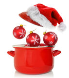 Cooking pot with Christmas ornaments Stock Images