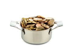 Cooking pot with coins Royalty Free Stock Image