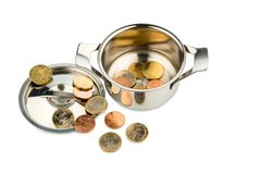 Cooking pot with coins Royalty Free Stock Photo
