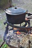 Cooking pot on fire Royalty Free Stock Photo
