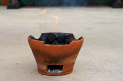 Cooking pot fire. The pot is cooking with fire. Look old classic,close up, portrail stock image