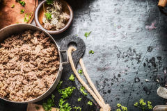 Cooking pot with frying ground beef on dark rustic kitchen table , top view Royalty Free Stock Photos