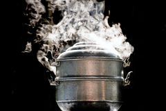Cooking pot in kitchen. Steam over cooking pot in kitchen Stock Images