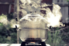 Cooking pot in kitchen Stock Photography