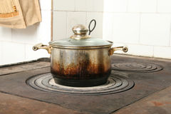 Cooking pot on old kitchen stove Stock Images