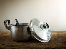 Cooking pot on old wooden table Royalty Free Stock Image