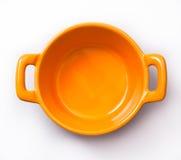 Cooking pot. Orange small cooking pot stock photos